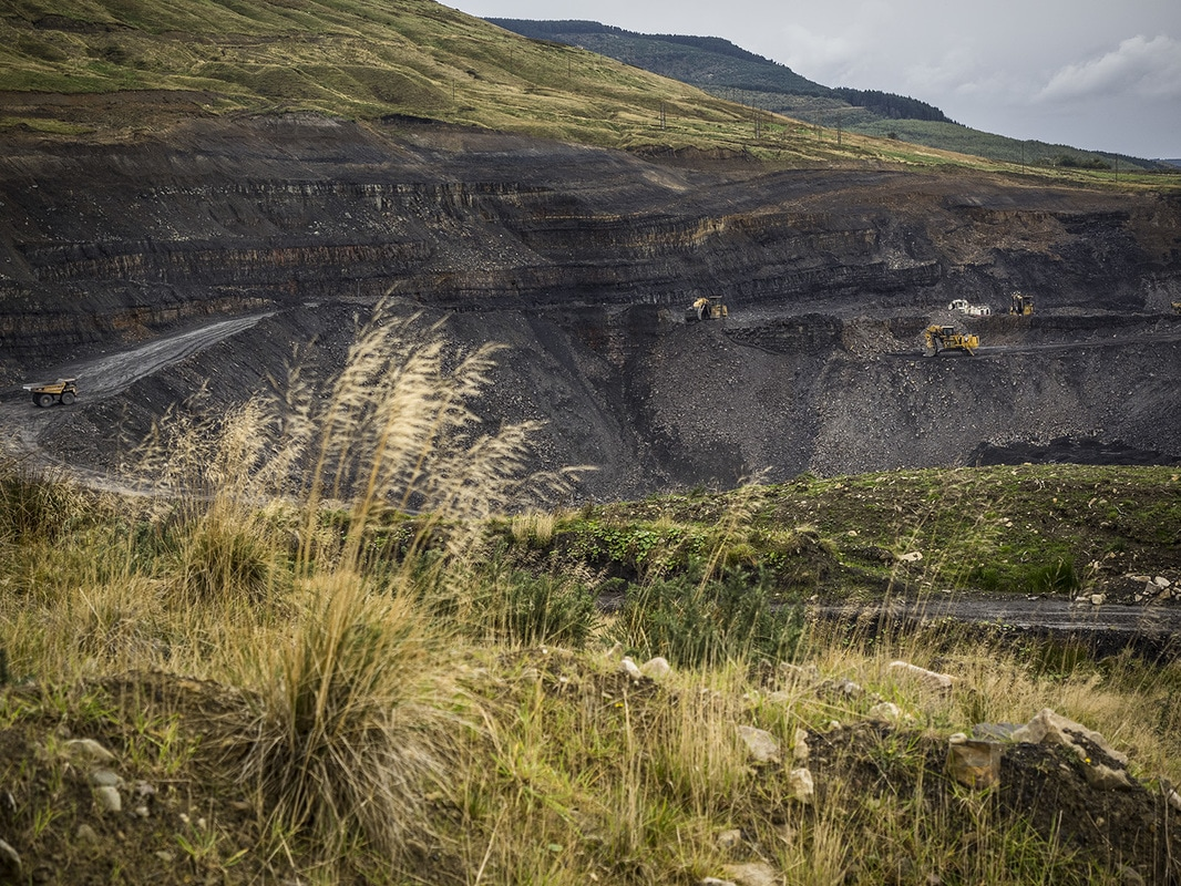 Coal seams and machines in the hillside near Hirwaun.
