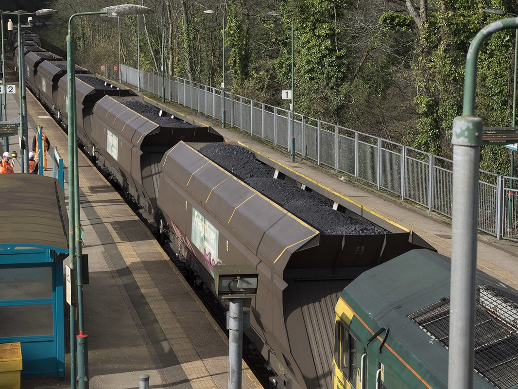 Loaded train passing slowly through Radar.